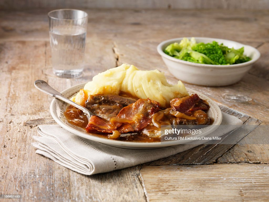 Liver and bacon with potatoes : Stock Photo