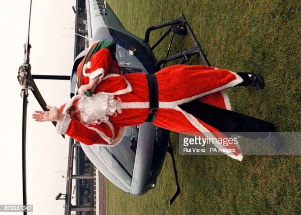 Liver transplant patient Paul Bundy dressed as Father Christmas swaps his sleigh for a helicopter as he arrives at Birmingham Children's Hospital to...