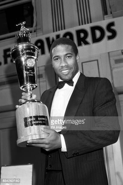 Liverpool and England footballer John Barnes with his trophy after being named Player of the Year by the Professional Footballers' Association