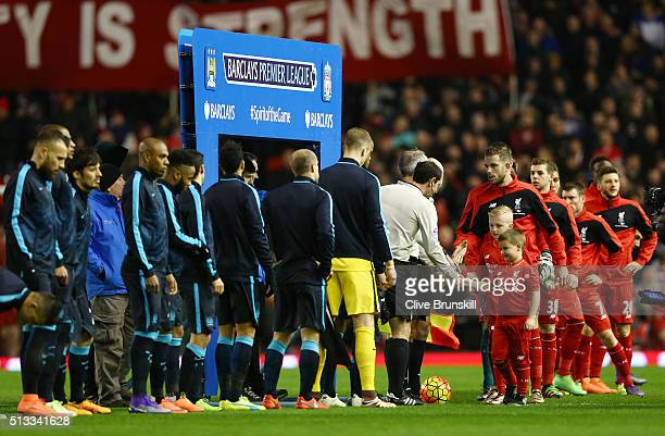 Liverpool and Manchester City players line up prior to the Barclays Premier League match between Liverpool and Manchester City at Anfield on March 2...
