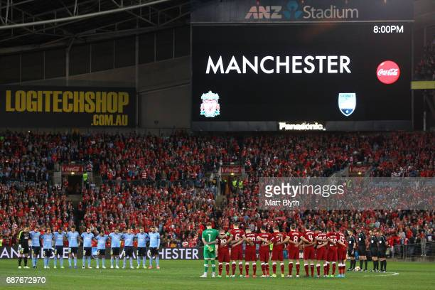 Liverpool and Sydney FC players observe a minute's silence in memory of the victims of last night's terror attack in Manchester before the...