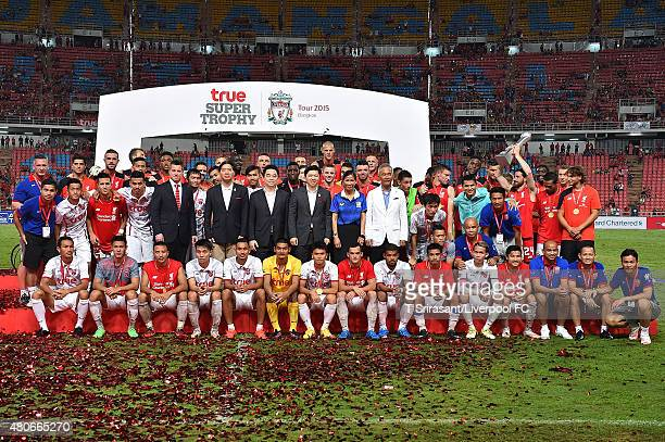 Liverpool and Thai Premier League All Stars celebrate with trophy during the international friendly match between Thai Premier League All Stars and...