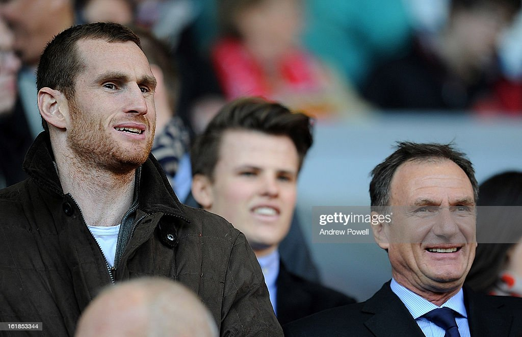 Liverpool boxer David Price and ex-Liverpool player Phil Thompson watch from the directors' box before the Barclays Premier League match between Liverpool and Swansea City at Anfield on February 17, 2013 in Liverpool, England.