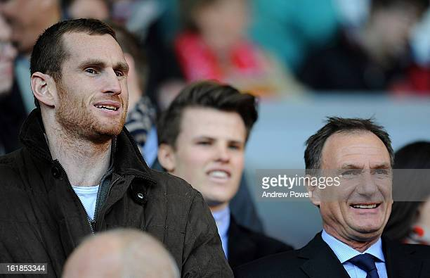 Liverpool boxer David Price and exLiverpool player Phil Thompson watch from the directors' box before the Barclays Premier League match between...