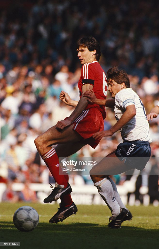 Liverpool captain Alan Hansen (l) is challenged by Spurs captain Gary Mabbutt during a First Division match between Liverpool and Tottenham Hotspur at Anfield on April 28, 1988 in Liverpool, England.