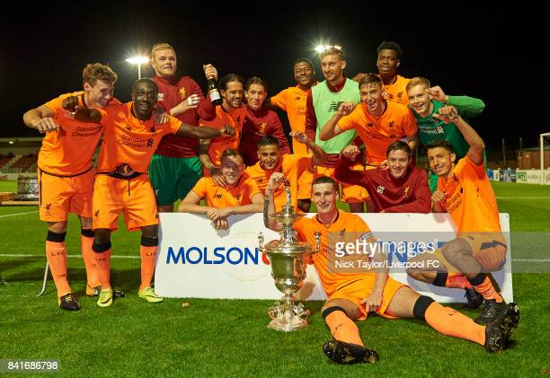 Liverpool captain Corey Whelan sits with the trophy after his team Matty Virtue Bobby Adekanye Andrew Firth Danny Ings George Johnston Harry Wilson...