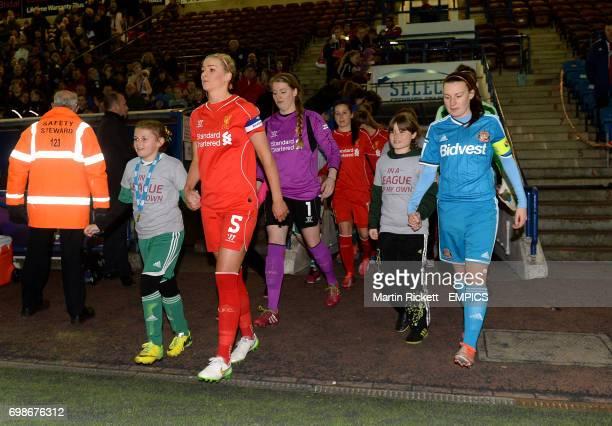 Liverpool captain Gemma Bonner and Sunderland captain Stephanie Bannon lead their teams out
