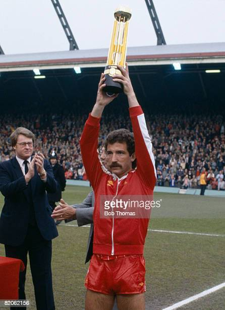 Liverpool captain Graeme Souness raises the Canon First Division Championship trophy after the presentation at Anfield prior to their match against...