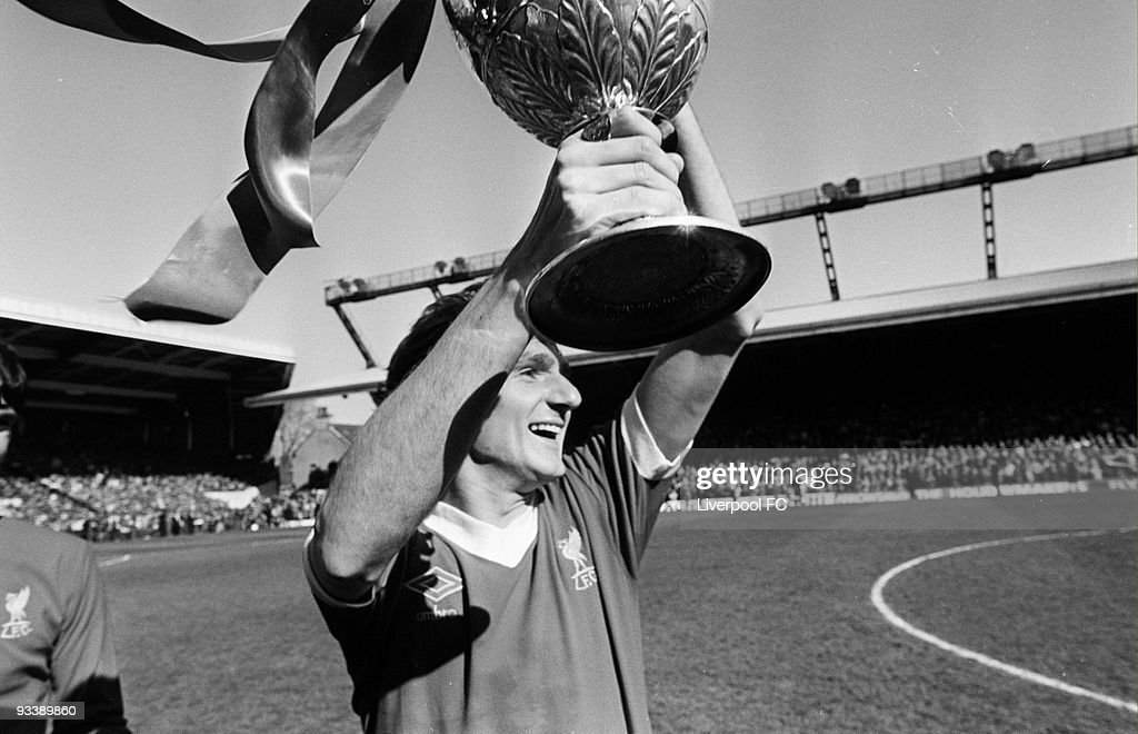 Liverpool captain <a gi-track='captionPersonalityLinkClicked' href=/galleries/search?phrase=Phil+Thompson&family=editorial&specificpeople=221560 ng-click='$event.stopPropagation()'>Phil Thompson</a> holds the Football League Division One trophy after the Football League Division One match between Liverpool and Aston Villa held on May 3, 1980 at Anfield in Liverpool, England. Liverpool won the match 4-1 winning the league championship.