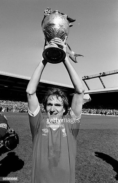 Liverpool captain Phil Thompson holds the Football League Division One trophy after the Football League Division One match between Liverpool and...