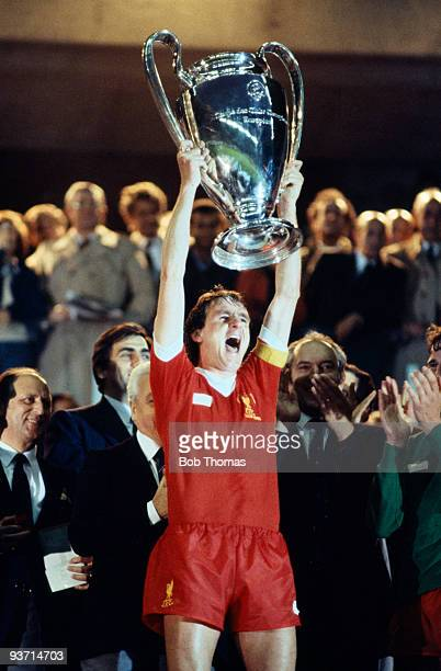 Liverpool captain Phil Thompson holds the trophy after the match between Liverpool and Real Madrid in the European Cup Final held at the Parc des...