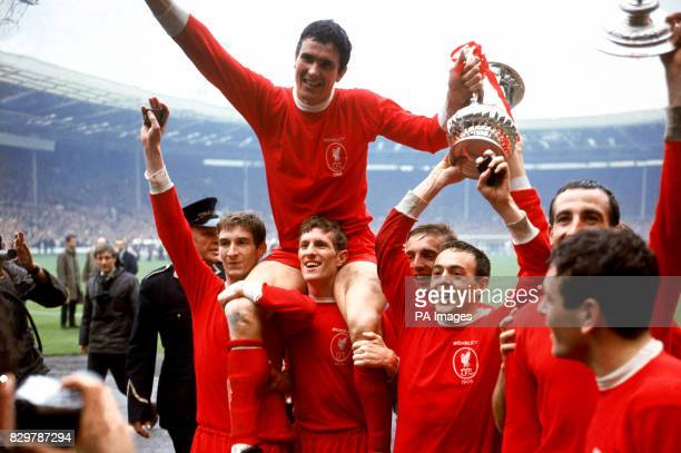 Liverpool captain Ron Yeats holds onto the FA Cup as he is hoisted aloft by his jubilant teammates after their 21 win Geoff Strong Yeats Wilf...