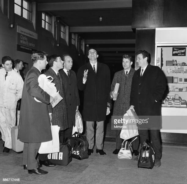 Liverpool captain Ron Yeats smiles as he flicks a coin into the air watched by fellow players following their arrival at Speke Airport from Cologne...