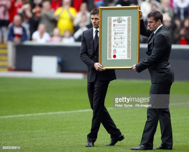 Liverpool captain Steven Gerrard and defender Jamie Carragher hold the Freedom Roll of Association which acknowledges the each of the families of...