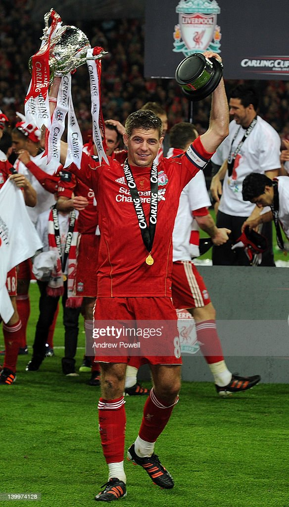 Liverpool captain <a gi-track='captionPersonalityLinkClicked' href=/galleries/search?phrase=Steven+Gerrard&family=editorial&specificpeople=202052 ng-click='$event.stopPropagation()'>Steven Gerrard</a> holds the trophy aloft at the end of the Carling Cup Final match between Liverpool and Cardiff City at Wembley Stadium on February 26, 2012 in London, England.