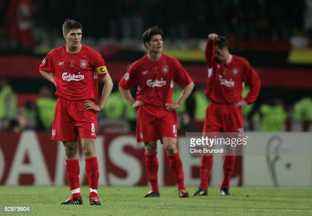 Liverpool captain Steven Gerrard Liverpool midfielder Xabi Alonso of Spain and Liverpool defender Jamie Carragher react during the European Champions...