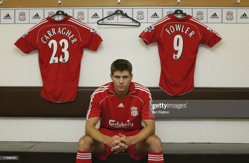 Liverpool captain <a gi-track='captionPersonalityLinkClicked' href=/galleries/search?phrase=Steven+Gerrard&family=editorial&specificpeople=202052 ng-click='$event.stopPropagation()'>Steven Gerrard</a> shows off the new home kit in the dressing room during the Liverpool FC Adidas Kit Launch at Anfield on July 24, 2006 in Liverpool, England.