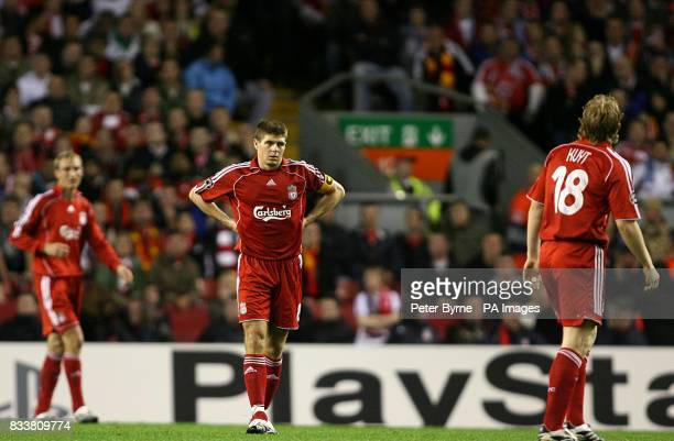 Liverpool captain Steven Gerrard stands dejected after Marseille take the lead through a Mathieu Valbuena strike