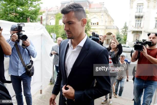 Liverpool defender Dejan Lovren arrives at a tribunal in the eastern Croatian town of Osijek on June 14 to testify as witness in a multimillioneuro...