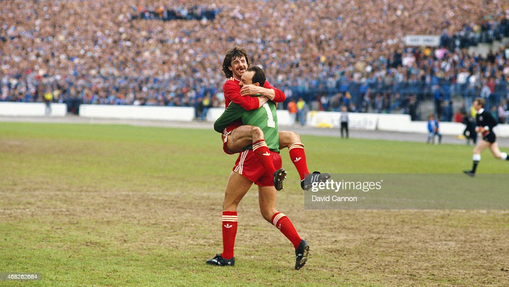 Liverpool defender Mark Lawrenson celebrates with goalkeeper Bruce Grobbelaar after Liverpool had won the 1985/86 First Division Title after the Division One match between Chelsea and Liverpool at Stamford Bridge on May 3, 1986 in London, England.
