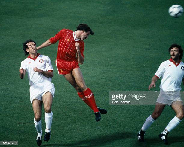 Liverpool defender Mark Lawrenson heads the ball away from AS Roma strikers Graziani and Pruzzo during the European Cup Final at the Olympic Stadium...