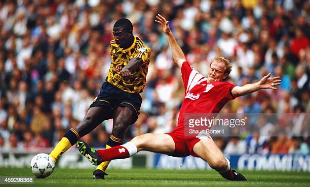 Liverpool defender Mark Wwright challenges Kevin Campbell of Arsenal during a FA Premier League match between Liverpool and Arsenal at Anfield on...