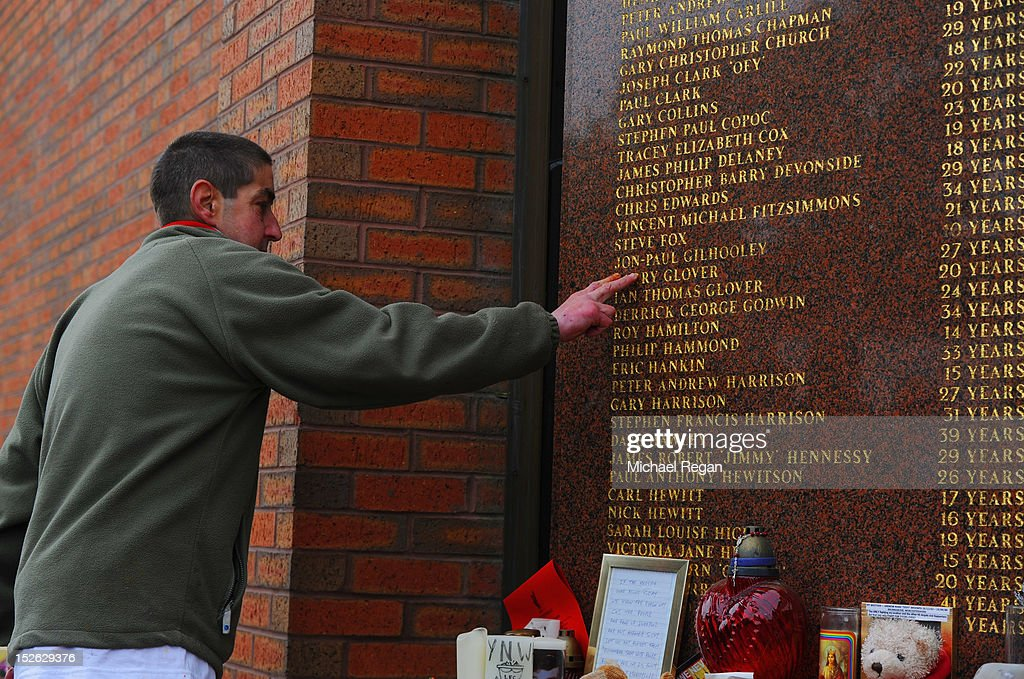 A Liverpool fan at the Hillsborough memorial before the Barclays Premier League match between Liverpool and Manchester United at Anfield on September 23, 2012 in Liverpool, England.