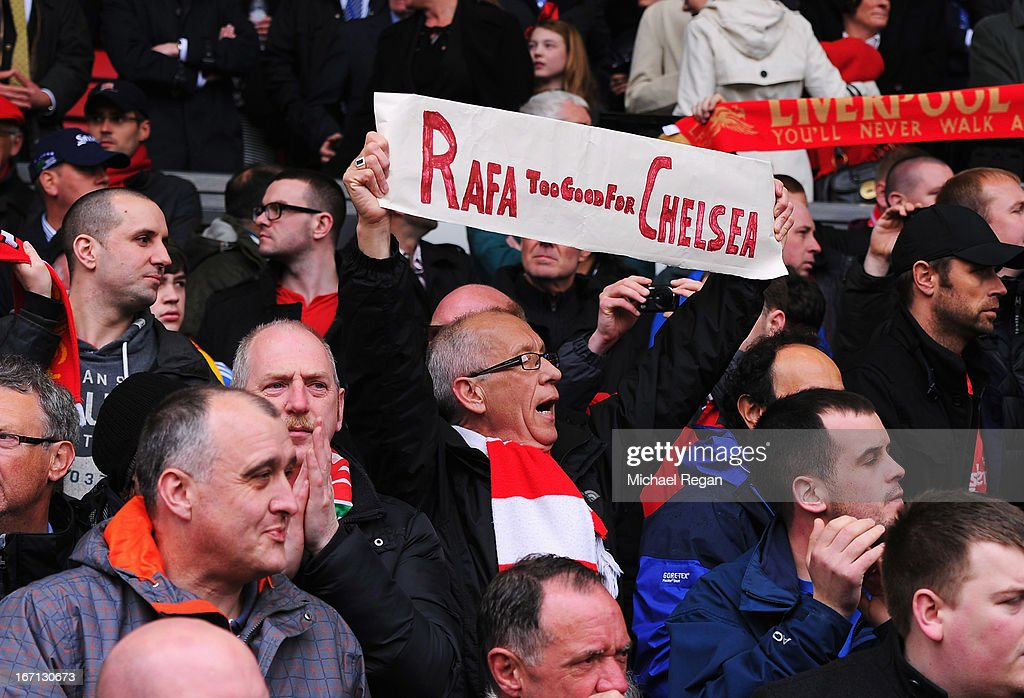 A Liverpool fan holds a sign in support of Rafael Benitez, interim manager of Chelsea prior to the Barclays Premier League match between Liverpool and Chelsea at Anfield on April 21, 2013 in Liverpool, England.