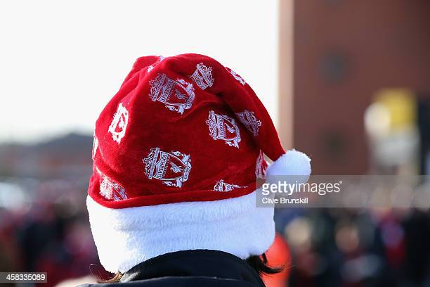 Liverpool fan in a christmas hat prior to the Barclays Premier League match between Liverpool and Cardiff City at Anfield at Anfield on December 21...