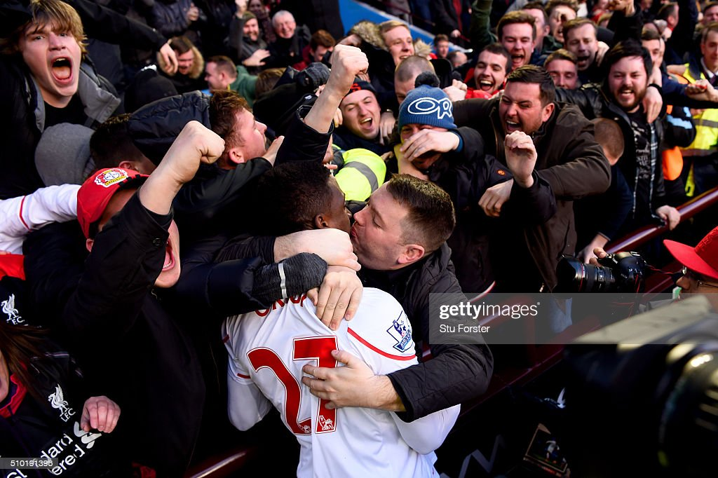 A Liverpool fan kisses <a gi-track='captionPersonalityLinkClicked' href=/galleries/search?phrase=Divock+Origi&family=editorial&specificpeople=10183754 ng-click='$event.stopPropagation()'>Divock Origi</a> of Liverpool as he celebrates after scoring his team's fourth goal during the Barclays Premier League match between Aston Villa and Liverpool at Villa Park on February 14, 2016 in Birmingham, England.