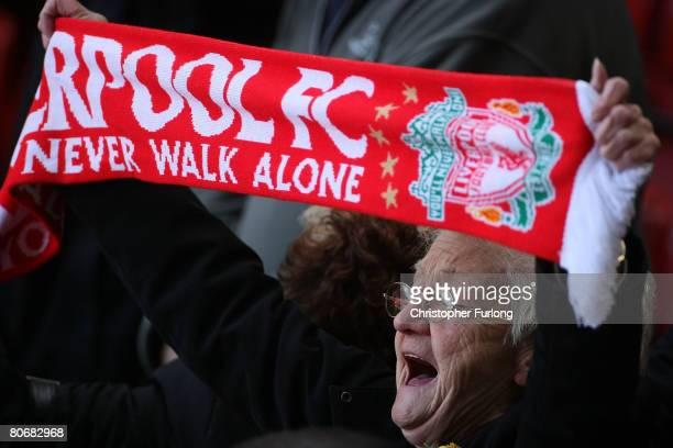 Liverpool fan sings 'You'll Never Walk Alone' during a service at Anfield football stadium in Liverpool to mark the 19th anniversary of the...
