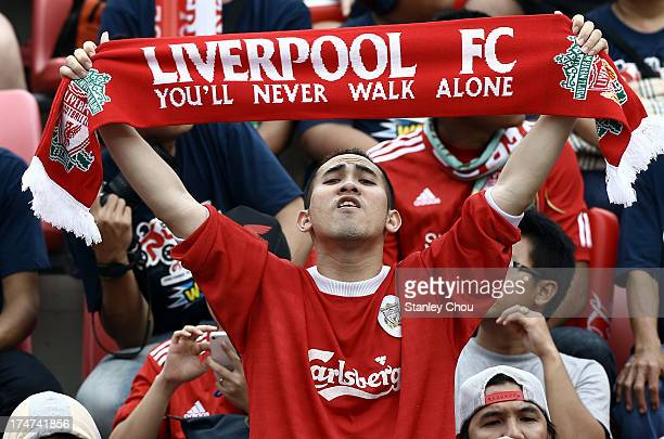 Liverpool fan sings 'You'll Never Walk Alone' during the international friendly match between Thailand and Liverpool at the Rajamangala Stadium on...