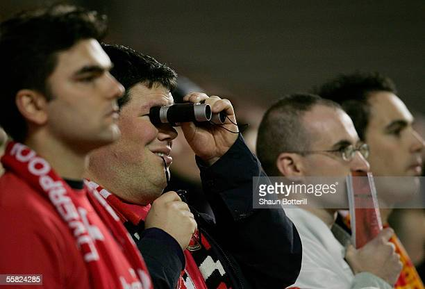 Liverpool fan watches the action through binoculars during the UEFA Champions League Group G match between Liverpool v Chelsea at Anfield on...
