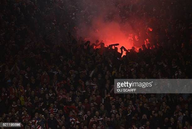 TOPSHOT Liverpool fans celebrate after Croatian defender Dejan Lovren scored the winning goal during the UEFA Europa league quarterfinal second leg...