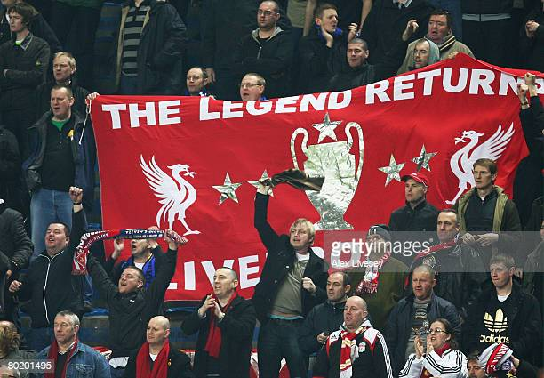 Liverpool fans cheer on their team during the UEFA Champions League first knockout round second leg match between Inter Milan and Liverpool at the...