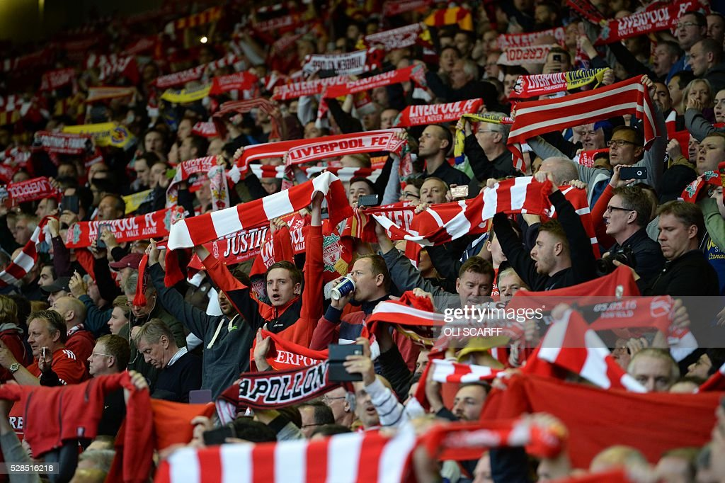 Liverpool fans cheer their team during the UEFA Europa League semi-final second leg football match between Liverpool and Villarreal CF at Anfield in Liverpool, northwest England on May 5, 2016. / AFP / OLI