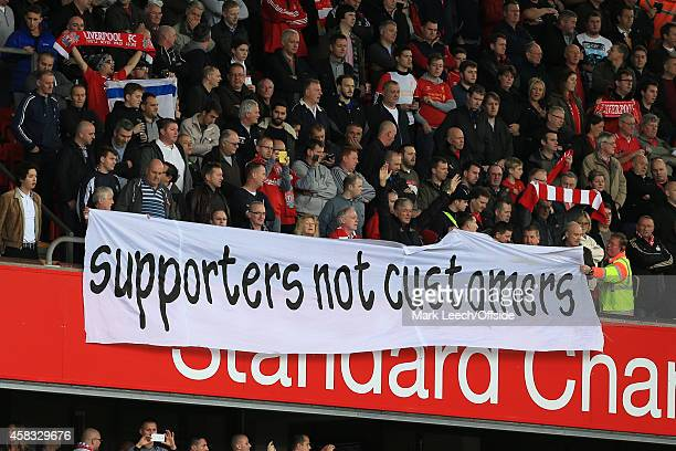 Liverpool fans display a banner as they protest against everrising ticket prices during the Barclays Premier League match between Liverpool and Hull...
