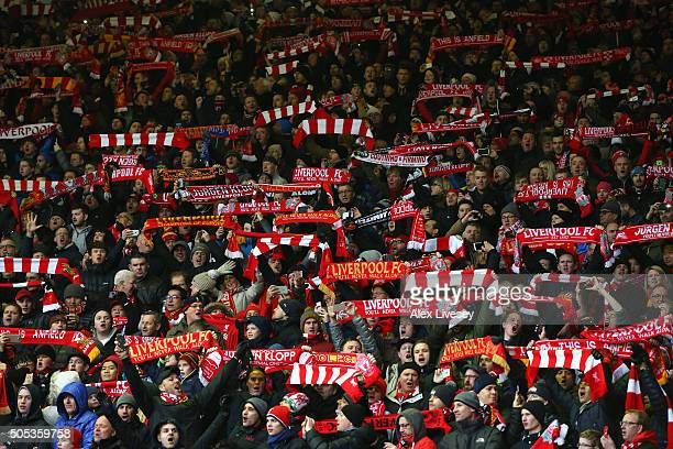 Liverpool fans display their scarves prior to the Barclays Premier League match between Liverpool and Manchester United at Anfield on January 17 2016...