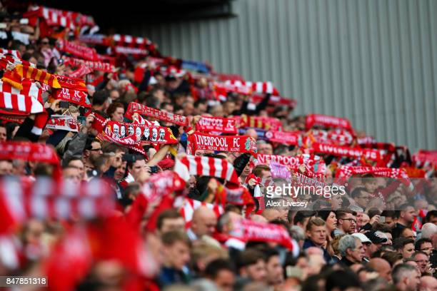 Liverpool fans displays scarfs during the Premier League match between Liverpool and Burnley at Anfield on September 16 2017 in Liverpool England