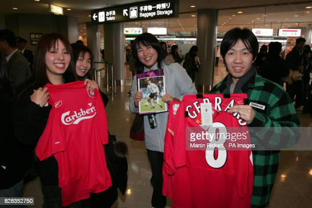Liverpool fans from Japan welcome the team at Narita Airport nr Tokyo Japan Monday December 12 2005 Liverpool will play the winners of Australia's...