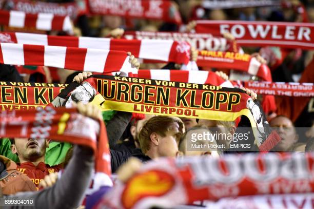 Liverpool fans hail new manager Jurgen Klopp with scarves in the stands before the game