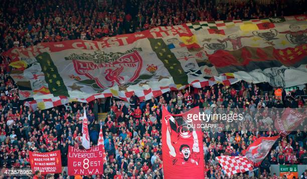 Liverpool fans hold banners and wave flags to honour Liverpool's English midfielder Steven Gerrard ahead of the English Premier League football match...