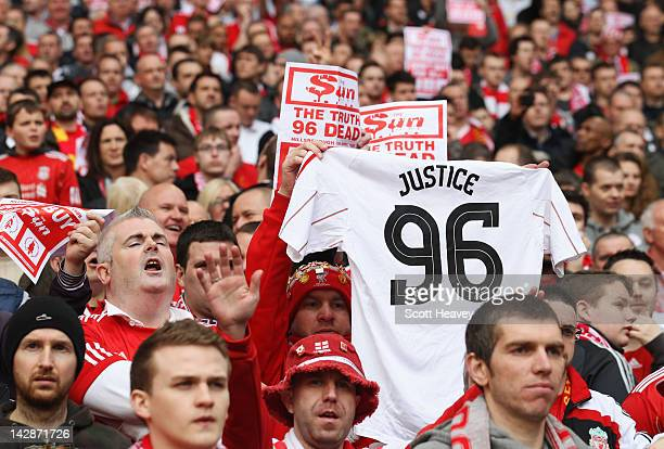Liverpool fans hold banners in protest against the Sun newspaper and show support for the 96 fans who died in the Hillsborough disaster during the FA...