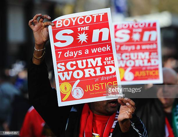 Liverpool fans hold banners protesting against The Sun newspaper outside the stadium prior to the Carling Cup Final match between Liverpool and...