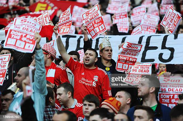 Liverpool fans hold banners protesting against The Sun newspaper prior to the Carling Cup Final match between Liverpool and Cardiff City at Wembley...