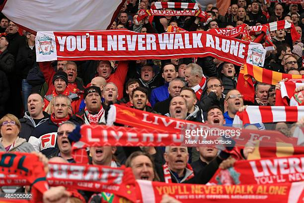 Liverpool fans hold their scarves aloft as they sing 'You'll Never Walk Alone' during the Barclays Premier League match between Liverpool and...