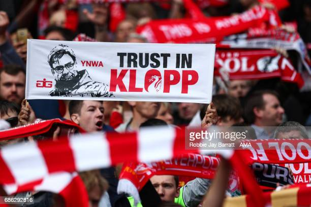 Liverpool fans hold up a sign saying Trust in Klopp during the Premier League match between Liverpool and Middlesbrough at Anfield on May 21 2017 in...