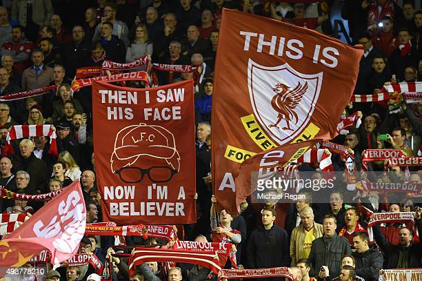Liverpool fans hold up banners during the UEFA Europa League Group B match between Liverpool FC and Rubin Kazan at Anfield on October 22 2015 in...