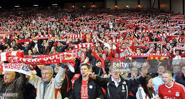Liverpool fans in the Kop crowd show their support during the Barclays Premier League match between LiverpooL FC and Manchester United at Anfield on...