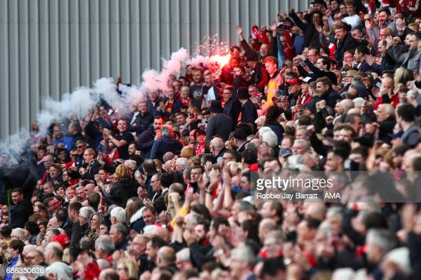 Liverpool fans let of flare at full time during the Premier League match between Liverpool and Middlesbrough at Anfield on May 21 2017 in Liverpool...